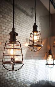 industrial lighting design. industrial pendant lighting caged light fixtures subway tile backsplash home decor design