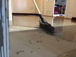 laying latex screed for a karndean floor