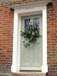 green front doorsLight green front door brick Pretty sure this is the new front