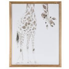 giraffe looking upside down wood wall