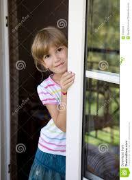 looking out door. Cute Smiling Girl Looking Out Balcony Door Y