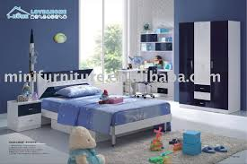 romantic theme navy blue bedroom interior with brown bedroom furniture bed and cupboard bedroom furniture teen boy bedroom baby furniture