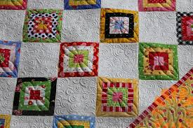 Piece N Quilt: Tiny Blocks - Custom Machine Quilting by Natalia Bonner & I've had a busy week of custom machine quilting. Just how I like it! Patti  made this adorable quilt with those teeny tiny blocks. Adamdwight.com