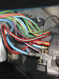 please help electric problem north american motoring when you look at the broken piece of black wire it is joint the purple wire connected to the turn signal assembly