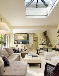 view in gallery sleek and stylish modern living space with central skylight