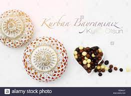Kurban Bayrami sacrifice festival, Islamic Arabic candle and chocolate  sugar. Kurban bayraminiz kutlu olsun means happy festival of sacrifices  Stock Photo - Alamy
