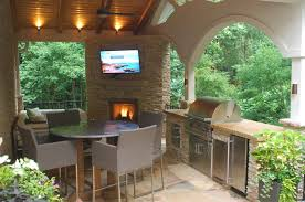 fireplace grill station stone patio and covered structure outside build a