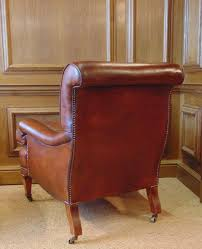 antique leather library chair with cherrywood legs boxwood inlay