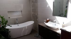 bathroom remodel with towel warmer and free standing tub