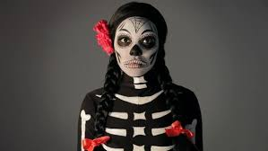 woman wearing day of the dead skeleton makeup and costume