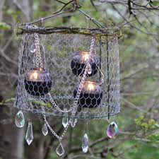 diy chandeliers that will light up your day candles and cage wire to create a wire chandelier
