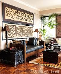 Framed kuba cloth and pillows in this global well-traveled style room.  Designer Carmen