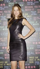 here is the beautiful hungarian model barbara palvin in two diffe outfits a clinging leather dress and a very tight leather mini skirt