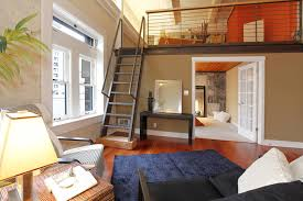 This home uses a loft to create two bedrooms. It's possible because of the  cathedral
