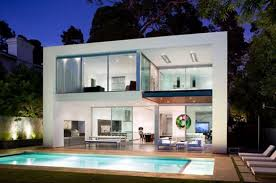 modern white home design with swimming pool and terrace also curtain wall also balcony also outdoor living furniture like lounge chairs and table