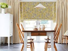 plain curtains with a patterned roman blind