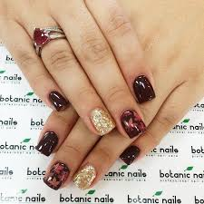 gel nail designs for fall 2014. beautiful red and dark color autumn leaves gel nail with glitter gold accent nail. designs for fall 2014