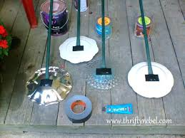 glass plate flowers using pipes as stems for garden plate flowers diy glass plate garden flowers