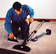 carpet stretcher. installer using a carpet stretcher