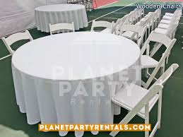 wooden white chair with padded seat and 60 round table and white round tablecloth inside