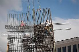 two construction workers install rebar for a new building at northern lights blvd and c street anchorage southcentral alaska summer stock photo rebar worker