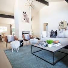 spacious midcentury modern living room with large sectional blue area rug and fur footstools mid century modern rugs blue n49 century
