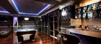fun game and entertainment room with dark wood floor and pool table