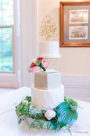 Contemporary Wedding Cake Decorated With Fresh Flowers And A Lovely