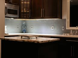 mobile kitchen island with seating smooth beige wooden countertop contemporary steel dishwasher white framed glass door four tier chandelier in glass box