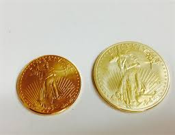 a genuine one ounce american eagle gold coin is on the left the item