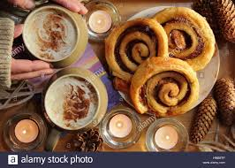 Candle Light Bakery A Man Reaches For Cream Topped Coffee Served With Cinnamon