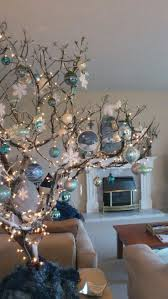 Modern look -- tree branch with Christmas decor in blue with white  snowflakes