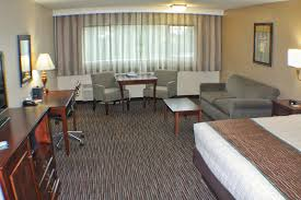 a seating area at best western plus inn at the vines