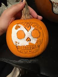 Last, add your colored details, then trace the outline you drew with black  paint. Voila! You have your perfect family of Sugar Skull Pumpkins.