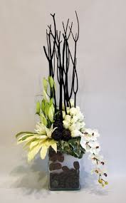 Unique Sympathy Flower Arrangements | Modern Sympathy Arrangement with  elegant lilies and tropical orchids.
