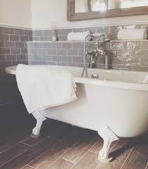 gray floor tile bathroom. this is one of the roll top baths at kedleston country house. #bathrooms. bathroom floor tilesdownstairs bathroomplum bathroommetro gray tile