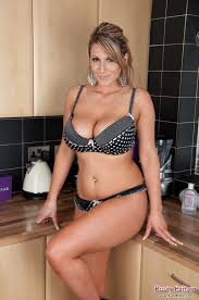Busty blonde milf working in the kitchen