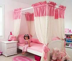 pink kids bedroom beige rug on wooden floor pink cabinet above bed white green bed sheet