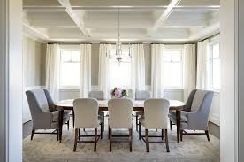 oval dining table with white and gray dining chairs