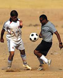 u s department of defense photo essay  a member of the mahus village soccer team challenges u s army spc jorje ortiz for