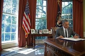 oval office july 2015. President Barack Obama Signs A Bill In The Oval Office Of White House, July 2015