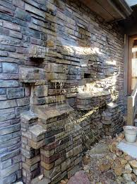 rock wall water feature foyer water wall features google search water feature