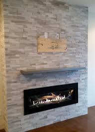 after cathedral stone wall replaced old gas fireplace