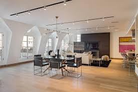 black track lighting. Unusual Windows Design Feat Black Area Rug Idea And Modern Living Room Track Lighting Plus Square