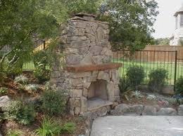backyard stone outdoor fireplace design