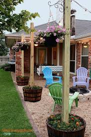 diy patio area with texas lamp posts add a patio with fun planter posts to a backyard area