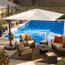 decorating backyard landscape with outdoor pool and pool deck also patio furniture with offset patio umbrella