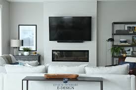sherwin williams collonade gray in living room kylie m interiors edesign tv above electric fireplace with tile surround