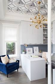 amazing home office with graphic ceiling and gold accents and navy chair amazing home offices