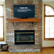 tv on brick fireplace hiding wires images